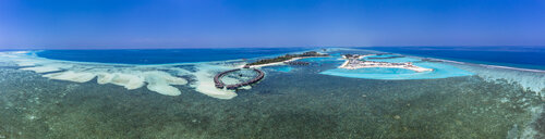 Aerial view over Olhuveli with water bungalow, South Male Atoll, Maldives - AMF07035