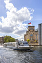 View to Reichstag with tourboat on Spree River in the foreground, Berlin, Germany - PUF01483