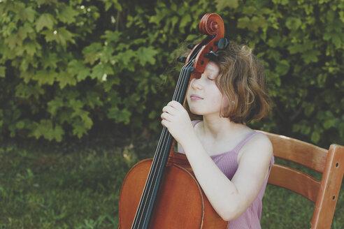 A girl taking a break during her cello exercises - IHF00023