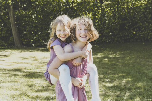 A big sister carrying her small sister, Girl power - IHF00032