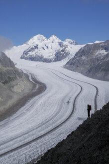 Caucasian hiker on snowy road, Aletsch Glacier, Canton Graubunden, Switzerland - BLEF03734