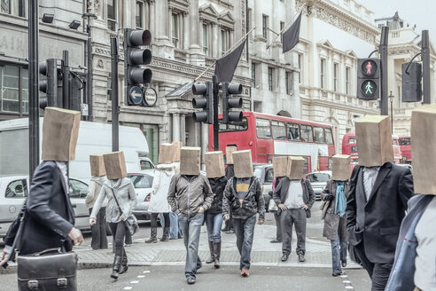 Anonymous people wearing paper bags on head in city - BLEF03746