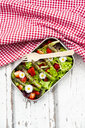 Lunchbox with green salad, green asparagus, strawberries and daisies - LVF08044
