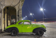 Parked vintage car at night, Havana, Cuba - HSIF00606