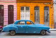 Parked blue vintage car in front of residential house, Havana, Cuba - HSIF00609