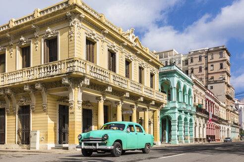 Vintage car driving in front of colonial buildings, Havana, Cuba - HSIF00615