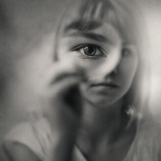 Caucasian girl looking through magnifying glass - BLEF03986