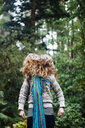 Caucasian woman tossing hair in forest - BLEF03998