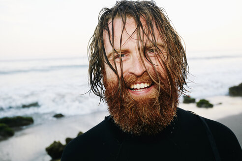 Caucasian surfer with wet hair at beach - BLEF04037