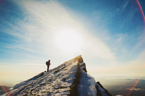 Man hiking on mountain in winter - BLEF04076