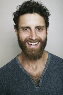 Smiling Caucasian man with beard looking at camera - BLEF04205