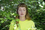 Portrait of young woman in the forest - FLLF00215