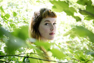Portrait of young woman in the forest - FLLF00218