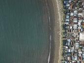 Indonesia, Sumbawa Island, Maluk, Aerial view of coastal town, beach - KNTF02771