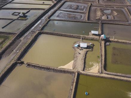 Indonesia, West Sumbawa, Maluk, Aerial view of shrimp farm and salt plantation - KNTF02783