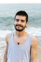 Portrait of smiling young man on the beach - AFVF03009