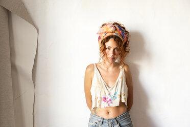 Portrait of young artist standing in her studio - JPTF00066