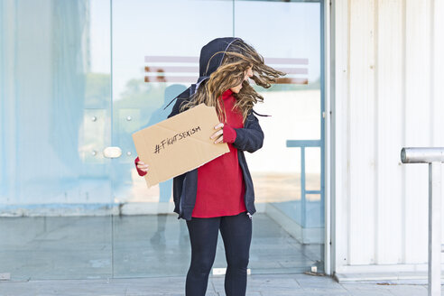 Screaming teenage girl showing the hashtag fight sexism on cardboard - ERRF01393