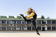 Happy teenage girl jumping outdoors - ERRF01402