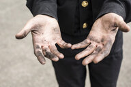 Close-up of dirty hands of a chimney sweep - MAEF12888