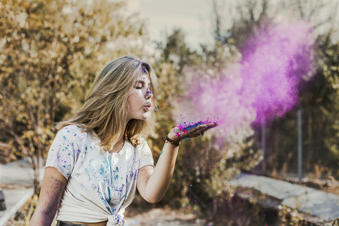 Girl blowing Holi powder colours, Germany - VGPF00028