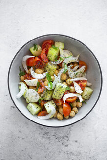 Salad with cucumbers, chickpeas, onion, cherry tomatoes, basil, chia seed - GIOF06354