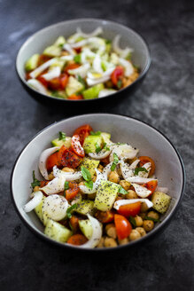 Salad with cucumbers, chickpeas, onion, cherry tomatoes, basil, chia seed - GIOF06357