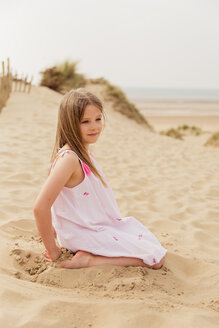 Portrait of girl sitting on the beach - NMS00307