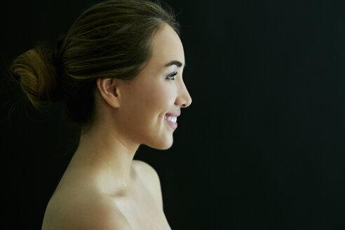 Profile of smiling naked Hispanic woman - BLEF04630