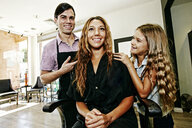 Hairdresser and customer in hair salon - BLEF05392