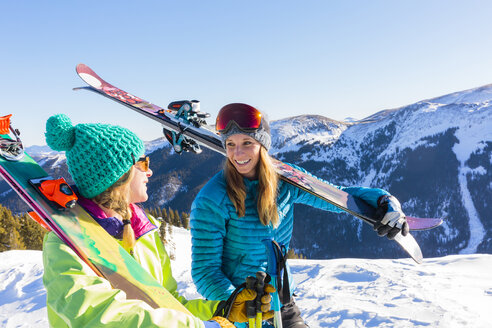 Women carrying skis on snowy mountain - BLEF05485