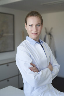 Portrait of confident female doctor in medical practice - PNEF01464