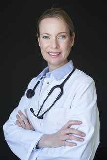 Portrait of confident female doctor - PNEF01506