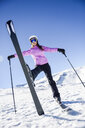 Happy woman in snow-covered landscape in Sierra Nevada, Andalusia, Spain - JSMF01107