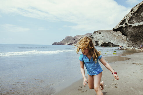 Girl running on the beach, San Jose, Almeria, Spain - LJF00026