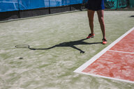 Close-up of female tennis player on court - LJF00044