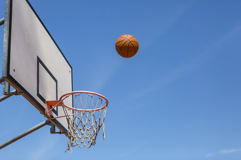 Basketball and hoop, blue sky - MGIF00519