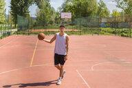 Young man playing basketball - MGIF00525