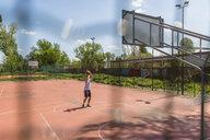 Young man playing basketball - MGIF00528