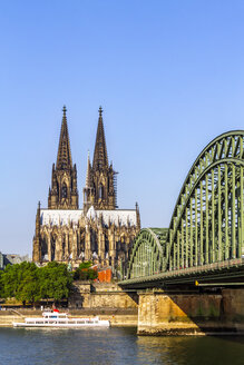 View to Cologne Cathedral with Hohenzollern Bridge and River Rhine in the foreground, Cologne, Germany - PUF01541