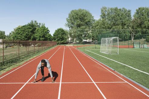 Runner on tartan track in starting position - AHSF00412