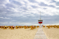 View to beach with hooded beach chairs and attendant's tower, Luebeck Travemuende, Germany - PUF01607
