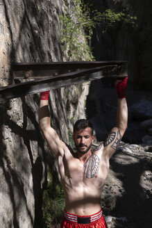 Training in the forest and waterfall/SPAIN/MONACHIL - LJF00068