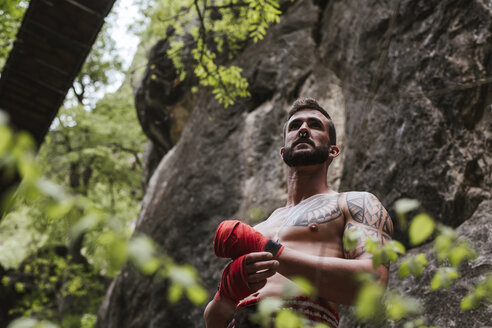 Tattooed boxer standing in nature - LJF00074
