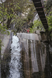 Young man doing boxing workout at a waterfall - LJF00077