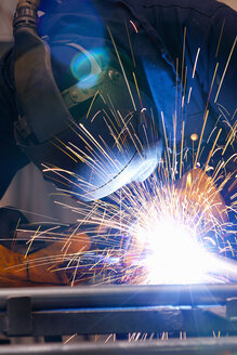 Close up of welder using welding saw - JUIF01052