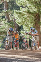 Family on mountain bikes in woods - JUIF01124