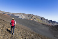 Tourist enjoying view from Sliding Sands Trail, Haleakala volcano, Haleakala National Park, Maui, Hawaii, USA - FOF10803