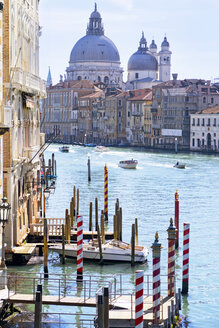 Boats in sunny Grand Canal in front of Santa Maria della Salute and architectural buildings in Venice, Italy - JUIF01171