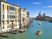 Water taxi boats on sunny Grand Canal in front of Santa Maria della Salute and architectural buildings in Venice, Italy - JUIF01180